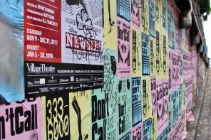 Posters along the wall leading into Post Alley, Seattle
