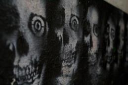Graffiti art found along the gutter in Post Alley, Seattle