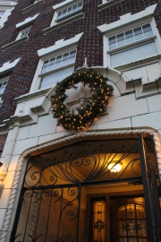 Beautiful wreath displayed on an apartment building's brick entrance, Queen Anne, Seattle