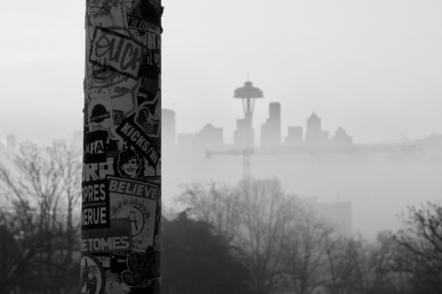 Light pole covered in stickers at Kerry Park. Photographed December 2017.